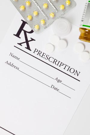Medical drug prescription and pills over it