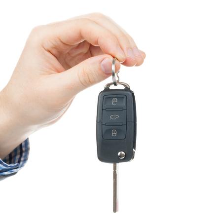 Male hand giving car keys - close up shot photo