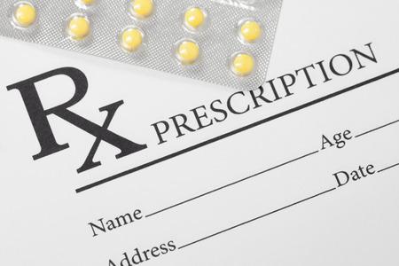 Medical drug prescription and pills over it - studio shot
