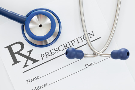 Stethoscope with drug prescription on table