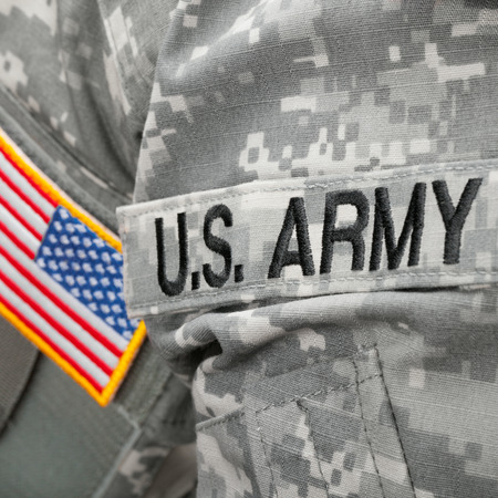 US Army and flag patch on military uniform - close up shot