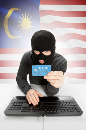 law breaking: Cybercrime concept with flag on background - Malaysia Stock Photo