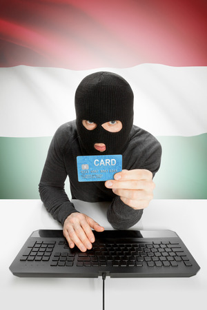 law breaking: Cybercrime concept with flag on background - Hungary Stock Photo