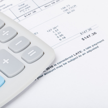 utility payments: Calculator with utility bill under it - close up shot Stock Photo