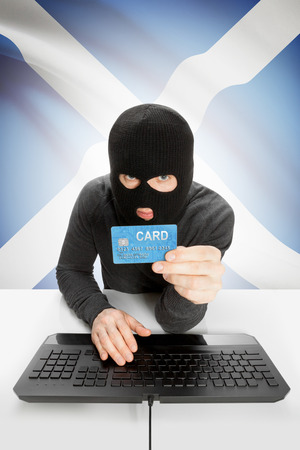law breaking: Cybercrime concept with flag on background - Scotland