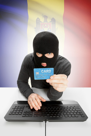 law breaking: Cybercrime concept with flag on background - Moldova Stock Photo