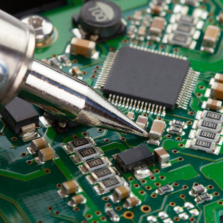 microcircuit: Soldering iron with microcircuit - close up shot