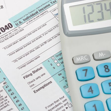 taxable income: US 1040 Tax Form and calculator - close up shot
