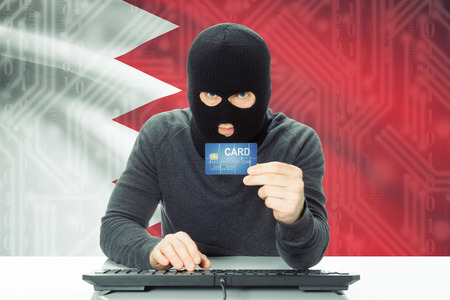 bahrain money: Cybercrime concept with flag on background - Bahrain Stock Photo