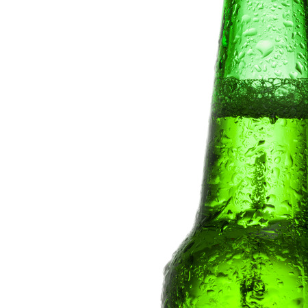 green beer bottle: Green beer bottle with water drops over white background - close up shot Stock Photo