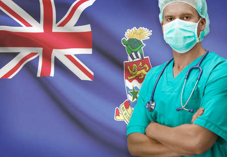 cayman islands: Surgeon with flag on background - Cayman Islands