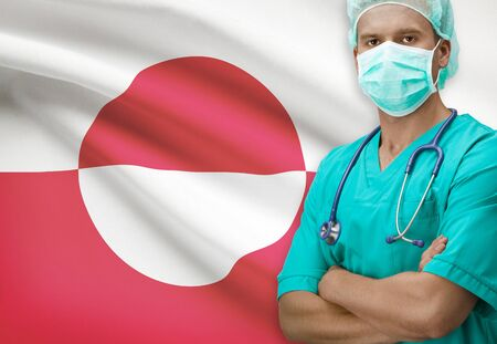 greenlandic: Surgeon with flag on background - Greenland Stock Photo