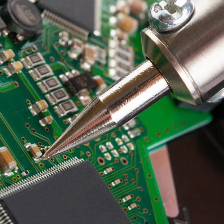 microcircuit: Soldering iron with microcircuit - closeup studio shot