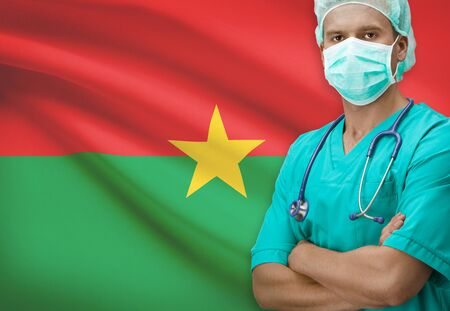 burkina faso: Surgeon with flag on background - Burkina Faso