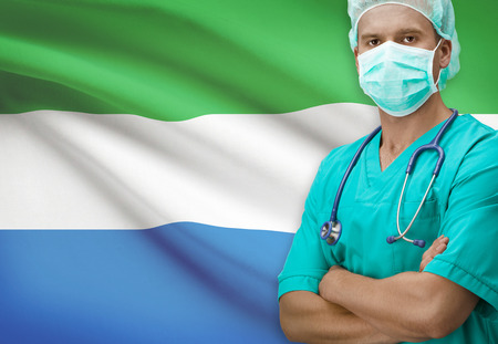 sierra: Surgeon with flag on background - Sierra Leone Stock Photo