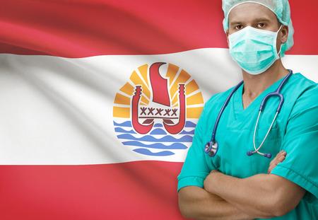 french polynesia: Surgeon with flag on background - French Polynesia