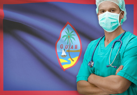 guam: Surgeon with flag on background - Guam