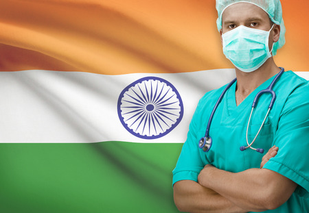 indian flag: Surgeon with flag on background - India Stock Photo