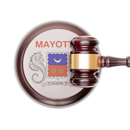 mayotte: National legal system concept with flag on sound block  - Mayotte