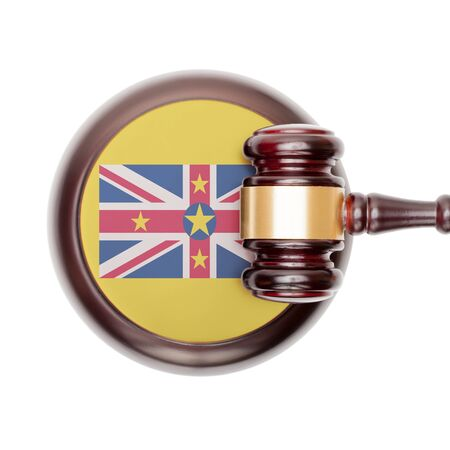niue: National legal system concept with flag on sound block  - Niue Stock Photo
