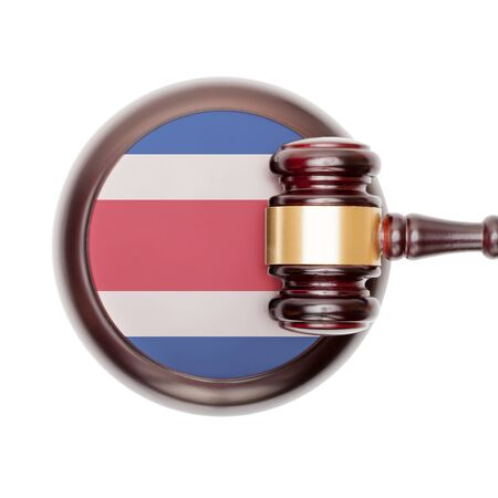 criminal case: National legal system concept with flag on sound block  - Costa Rica