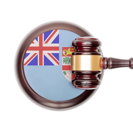 fijian: National legal system concept with flag on sound block  - Fiji