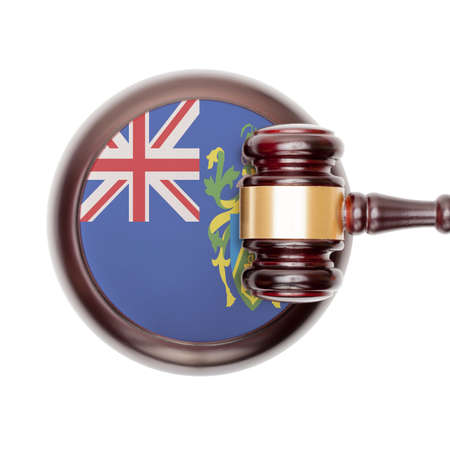 pitcairn: National legal system concept with flag on sound block  - Pitcairn Island