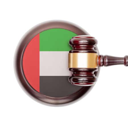 united arab emirates: National legal system concept with flag on sound block  - United Arab Emirates