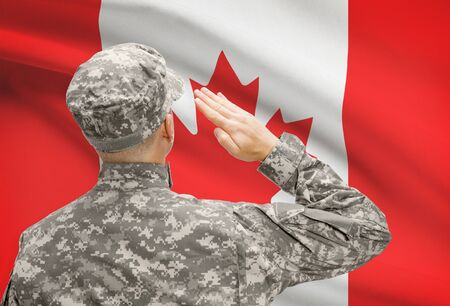 patriotism: National military forces with flag on background conceptual series - Canada Stock Photo