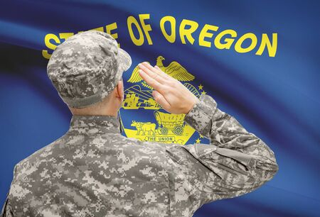 state of oregon: Soldier saluting to USA state flag conceptual series - Oregon