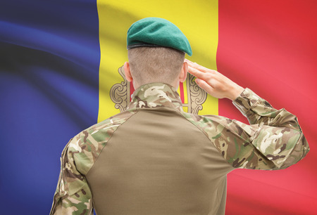 sovereignty: Soldier in hat facing national flag series - Andorra Stock Photo
