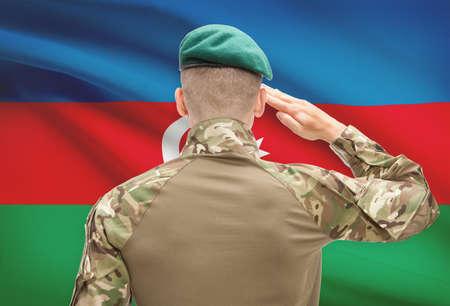 azerbaijani: Soldier in hat facing national flag series - Azerbaijan