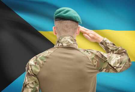 bahamas celebration: Soldier in hat facing national flag series - Bahamas Stock Photo
