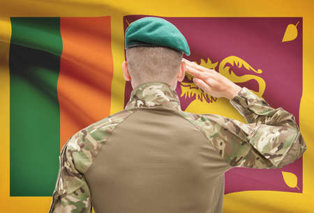 sri lankan flag: Soldier in hat facing national flag series - Sri Lanka