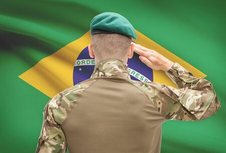 Soldier in hat facing national flag series - Brazil