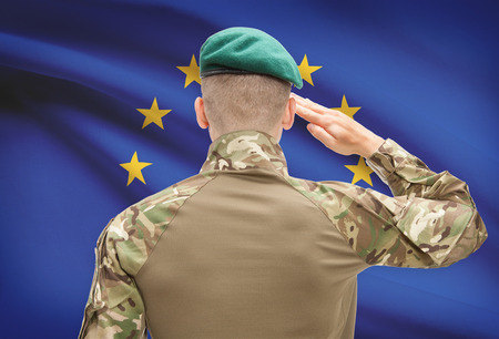 Soldier in hat facing national flag series - European Union - EU Фото со стока