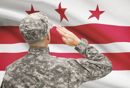 columbia district: Soldier saluting to USA state flag conceptual series - District of Columbia