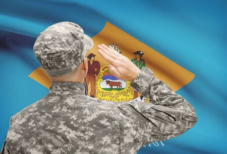 united states air force: Soldier saluting to USA state flag conceptual series - Delaware Stock Photo