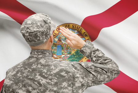 floridian: Soldier saluting to USA state flag conceptual series - Florida
