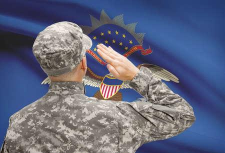 north dakota: Soldier saluting to USA state flag conceptual series - North Dakota