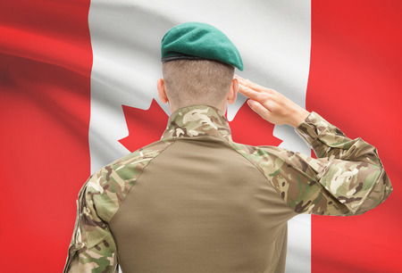 canadian flag: Soldier in hat facing national flag series - Canada