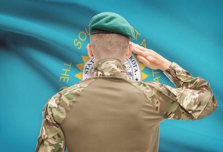 south dakota: Soldier saluting to US state flag series - South Dakota