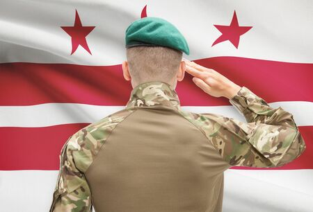 columbia district: Soldier saluting to US state flag series - District of Columbia Stock Photo