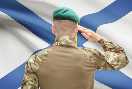 nova scotia: Soldier saluting to Canadial province flag series - Nova Scotia Stock Photo