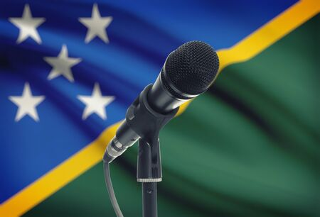 solomon: Microphone with national flag on background series - Solomon Islands