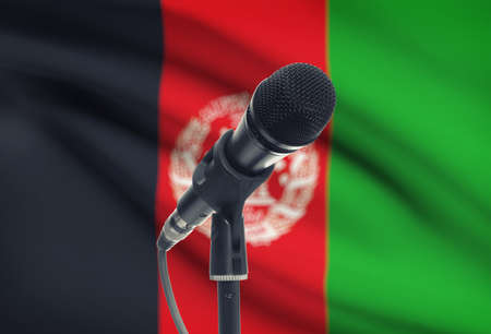 afghan flag: Microphone with national flag on background series - Afghanistan