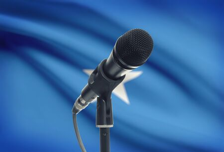 somalian culture: Microphone with national flag on background series - Somalia
