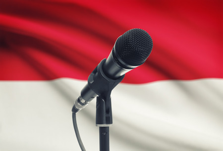monegasque: Microphone with national flag on background series - Monaco