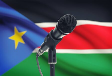 south sudan: Microphone with national flag on background series - South Sudan