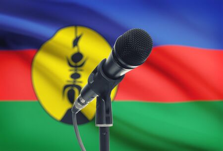 new caledonia: Microphone with national flag on background series - New Caledonia